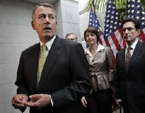 Speaker of the House John Boehner talks with reporters Nov. 15, 2011, following a Republican strategy session at the Capitol.
