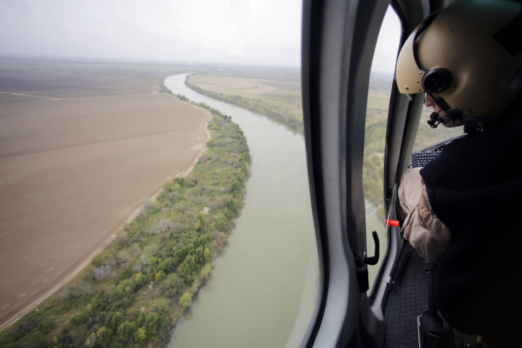 In this Feb. 24, 2015 photo, U.S. Customs and Border Protection Air and Marine agents patrol along the Rio Grande on the Texas-Mexico border near Rio Grande City, Texas. AP Photo