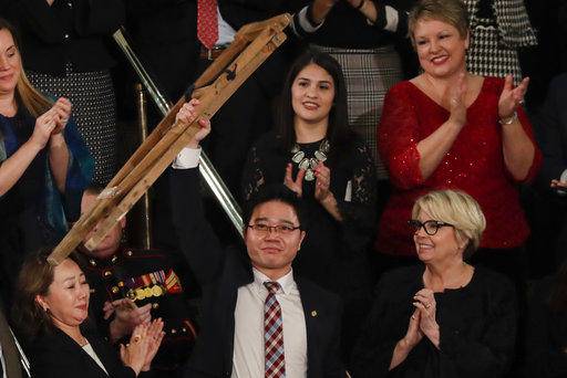 Ji Seong-ho holds up his crutches after his introduction by President Trump during the State of the Union address to a joint session of Congress on Capitol Hill in Washington, Jan. 30, 2018. (AP)