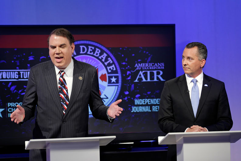 U.S. Reps. Alan Grayson, D-Orlando, and David Jolly, R-Indian Shores, met in an open debate in Orlando on April 25, 2016. (AP photo)