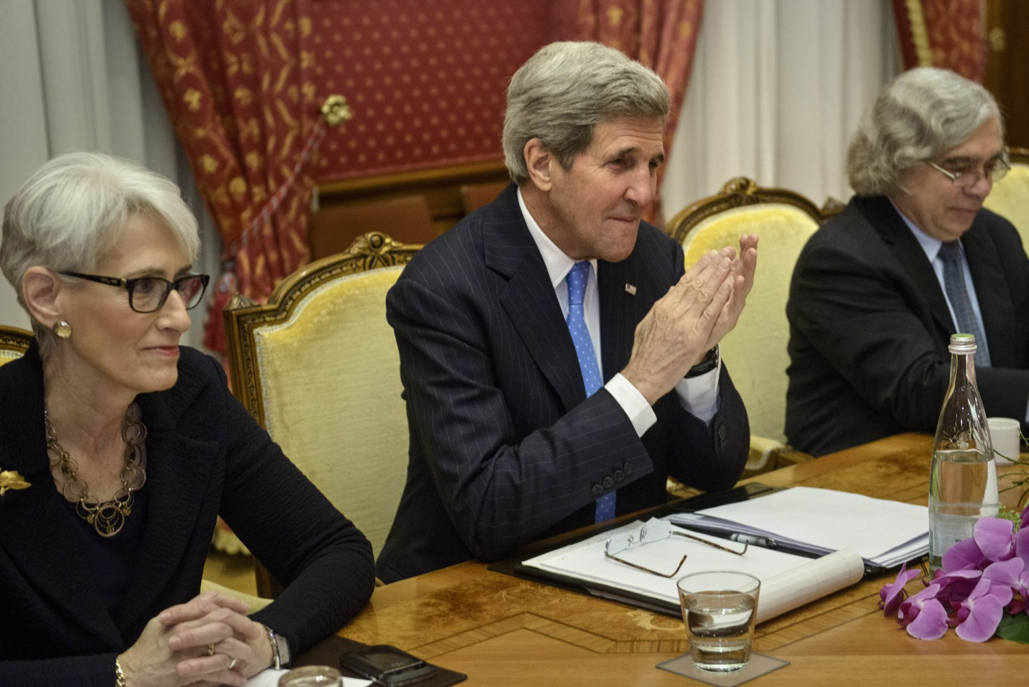 Under Secretary for Political Affairs Wendy Sherman, U.S. Secretary of State John Kerry and U.S. Secretary of Energy Ernest Moniz wait for a meeting with the Iranians in Switzerland on March 29, 2015.