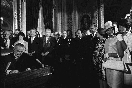 President Lyndon B. Johnson signed the Voting Rights Act into law Aug. 6, 1965 (Photo, LBJ Library / Yoichi Okamoto).