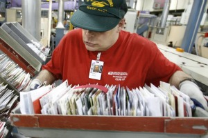 Mail piles up, the old-fashioned way (AP photo).