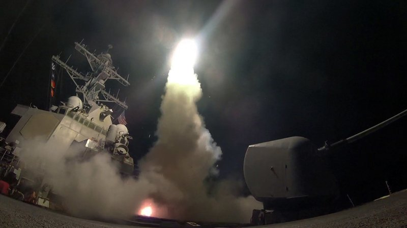 In this image provided by the U.S. Navy, the guided-missile destroyer USS Porter (DDG 78) launches a tomahawk land attack missile in the Mediterranean Sea, Friday, April 7, 2017.  (Mass Communication Specialist 3rd Class Ford Williams/U.S. Navy via AP)