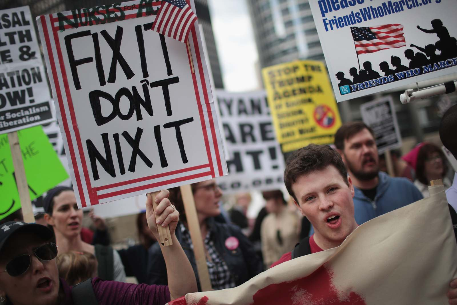 Demonstrators gather near Trump Tower in Chicago to celebrate the defeat of President Donald Trump's revision of the Affordable Care Act March 24, 2017. (Scott Olson/Getty Images)