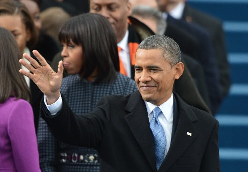President Barack Obama smiles as he arrives for the 57th Presidential Inauguration ceremonial swearing-in at the US Capitol.