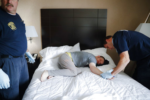 In this Nov. 2, 2017, file photo, Cincinnati police officers, firefighters and medics respond to a possible overdose report at a hotel in downtown Cincinnati.(AP)