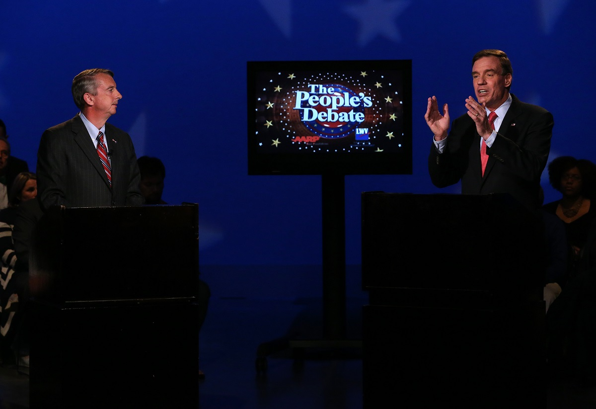 Sen. Mark Warner, D-Va., right, gestures as Republican challenger Ed Gillespie listens during Monday night's People's Debate at WCVE studios in Chesterfield County.