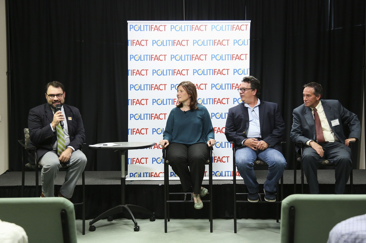 (from left to right) Aaron Sharockman, Politifact Executive Director introduces a panel featuring Angie Holan, Politifact Editor, PolitiFact founder Bill Adair and Tampa Bay Times Editor Neil Brown at the Poynter Institute on August 22, 2017. (Times)