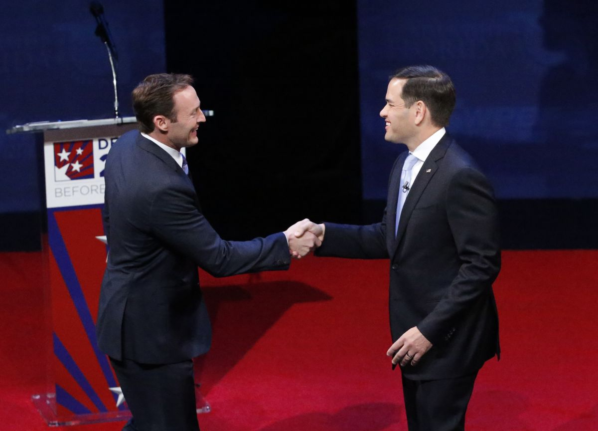 Rep. Patrick Murphy, left, and Sen. Marco Rubio shake hands before the start of a debate, Wednesday, Oct. 26, 2016, at Broward College in Davie, Fla. Rubio and Murphy held their second and final debate, 13 days before the election.