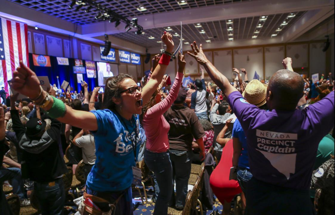 Supporters of Democratic presidential candidate Bernie Sanders react during the Nevada Democratic Party's 2016 State Convention Las Vegas May 14. (Chase Stevens/Las Vegas Review-Journal via AP)