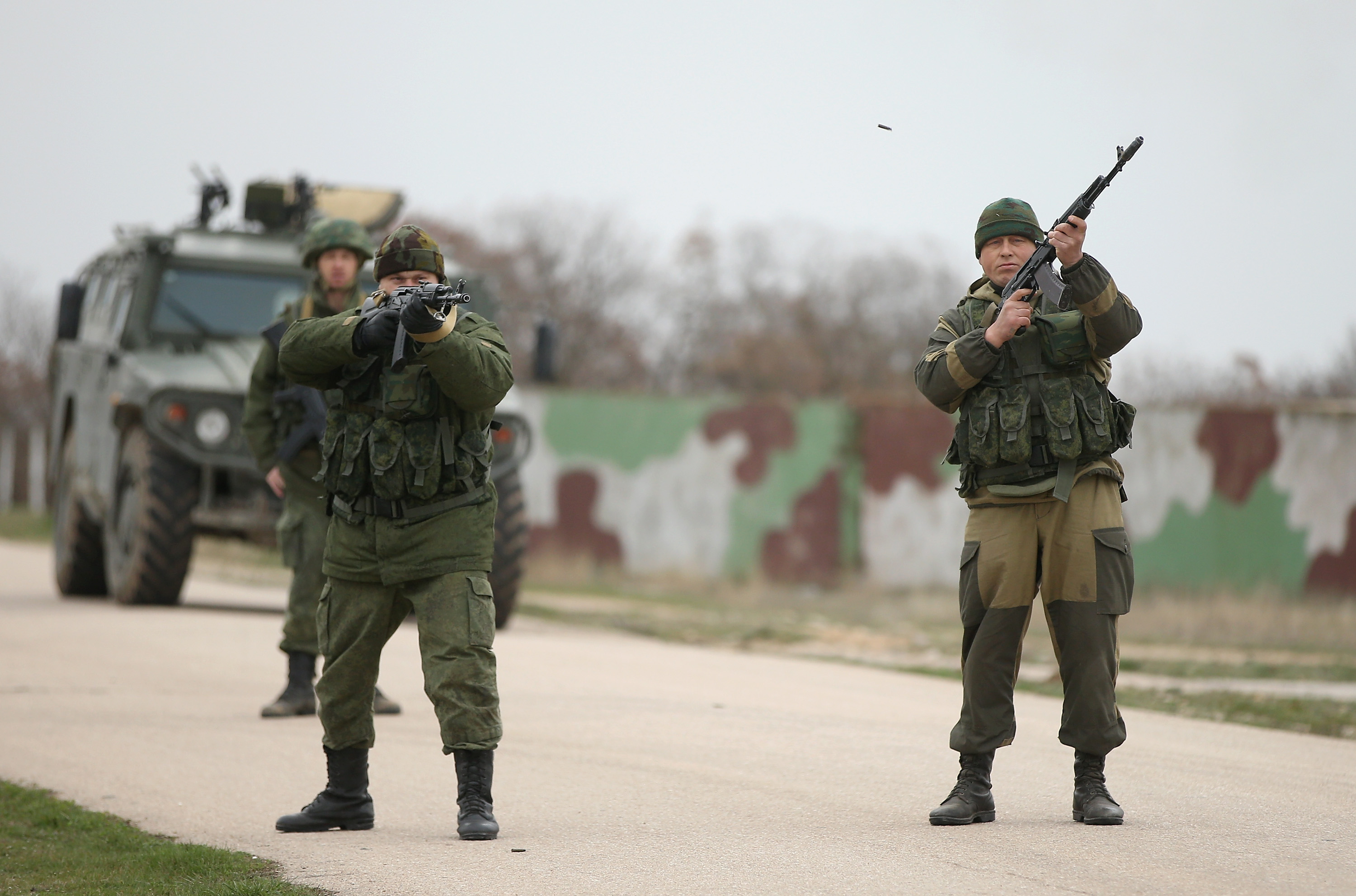 Troops under Russian command and in unmarked uniforms fired their weapons into the air on March 4 to warn Ukrainian troops to turn back at the Russian-occupied Belbek airbase in Crimea (Getty Images).