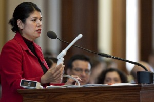 State Rep. Carol Alvarado holds a vaginal probe on the Texas House floor March 2.