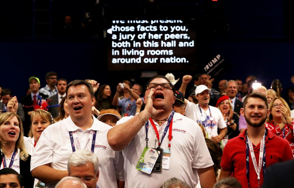 A screen projects the speech of New Jersey Gov. Chris Christie as delegates participate during his talk on the second day of the Republican National Convention on July 19, 2016 at the Quicken Loans Arena in Cleveland, Ohio. (Getty)