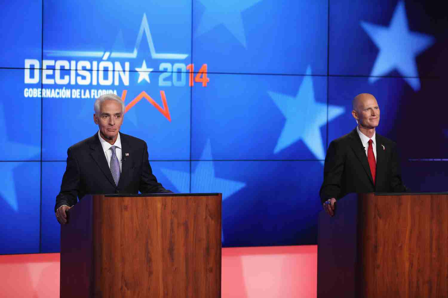 Former Gov. Charlie Crist and current Gov. Rick Scott in a debate hosted by Telemundo on Oct. 10, 2014.