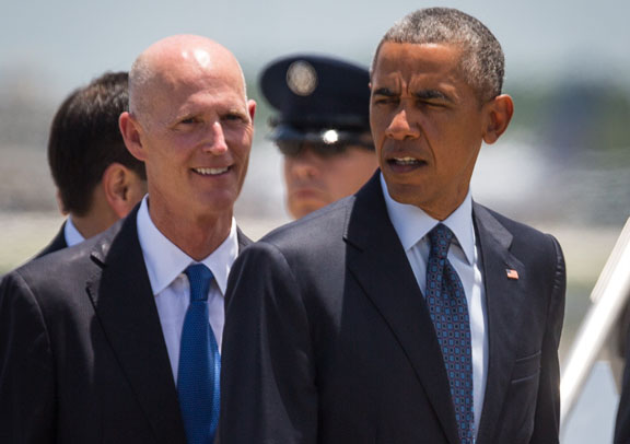 Gov. Rick Scott and President Barack Obama meet at Orlando International Airport on June 16, 2016. (Tampa Bay Times photo)