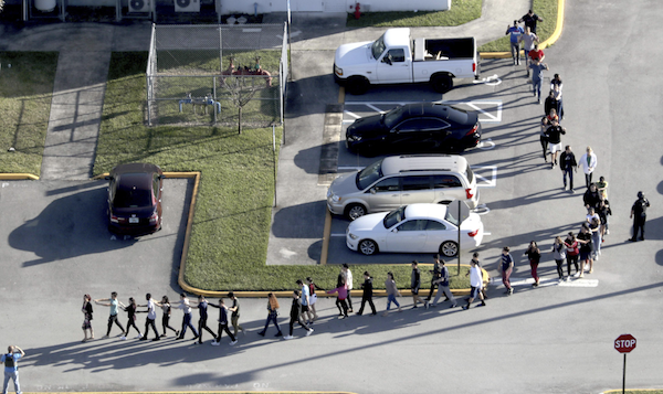 Students Are Evacuated By Police From Marjorie Stoneman Douglas High School In Parkland Fla