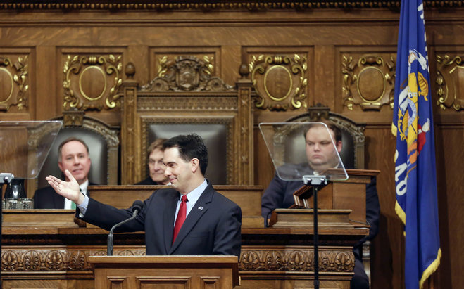 Wisconsin Gov. Scott Walker acknowledges guests during his State of the State address on Jan. 22, 2014