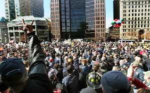 Thousands protested outside the Ohio Statehouse over efforts to revamp collective bargaining laws for public employees. Senate President cited one foul act in particular.