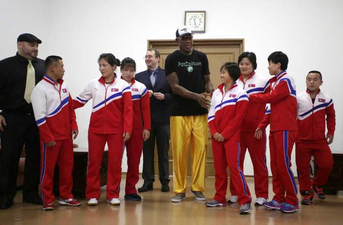 Former NBA basketball star Dennis Rodman, center, poses with North Korean Olympic athletes June 15, 2017, in Pyongyang, North Korea. (AP/Kim Kwang Hyon)