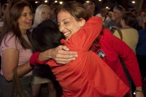 Austin City Council candidate Kathie Tovo, right, hugs council member Sheryl Cole at Tovo's election results party on May 14. She's headed into a June 18 runoff race against incumbent Randi Shade.