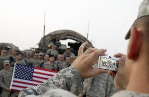 U.S. Army soldiers pose for a photo after crossing the border from Iraq into Kuwait on Aug. 16.