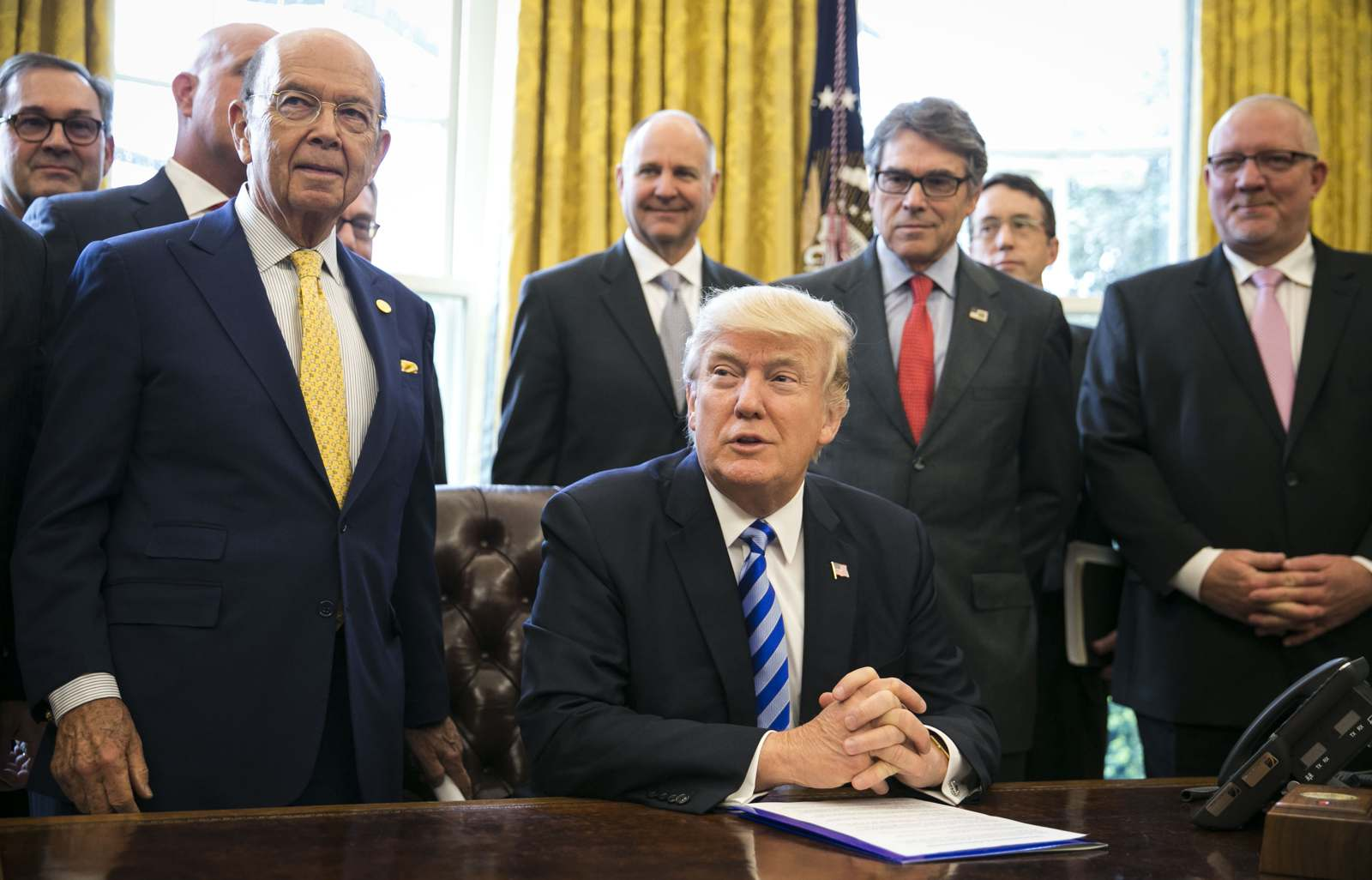 President Donald Trump announces that his administration will issue a permit for the construction of the Keystone XL pipeline March 24, 2017. (Al Drago/The New York Times)