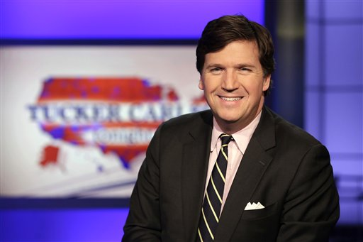 Fox News talk show host Tucker Carlson poses for photos in a Fox News Channel studio in New York on March 2, 2017. (AP/Drew)