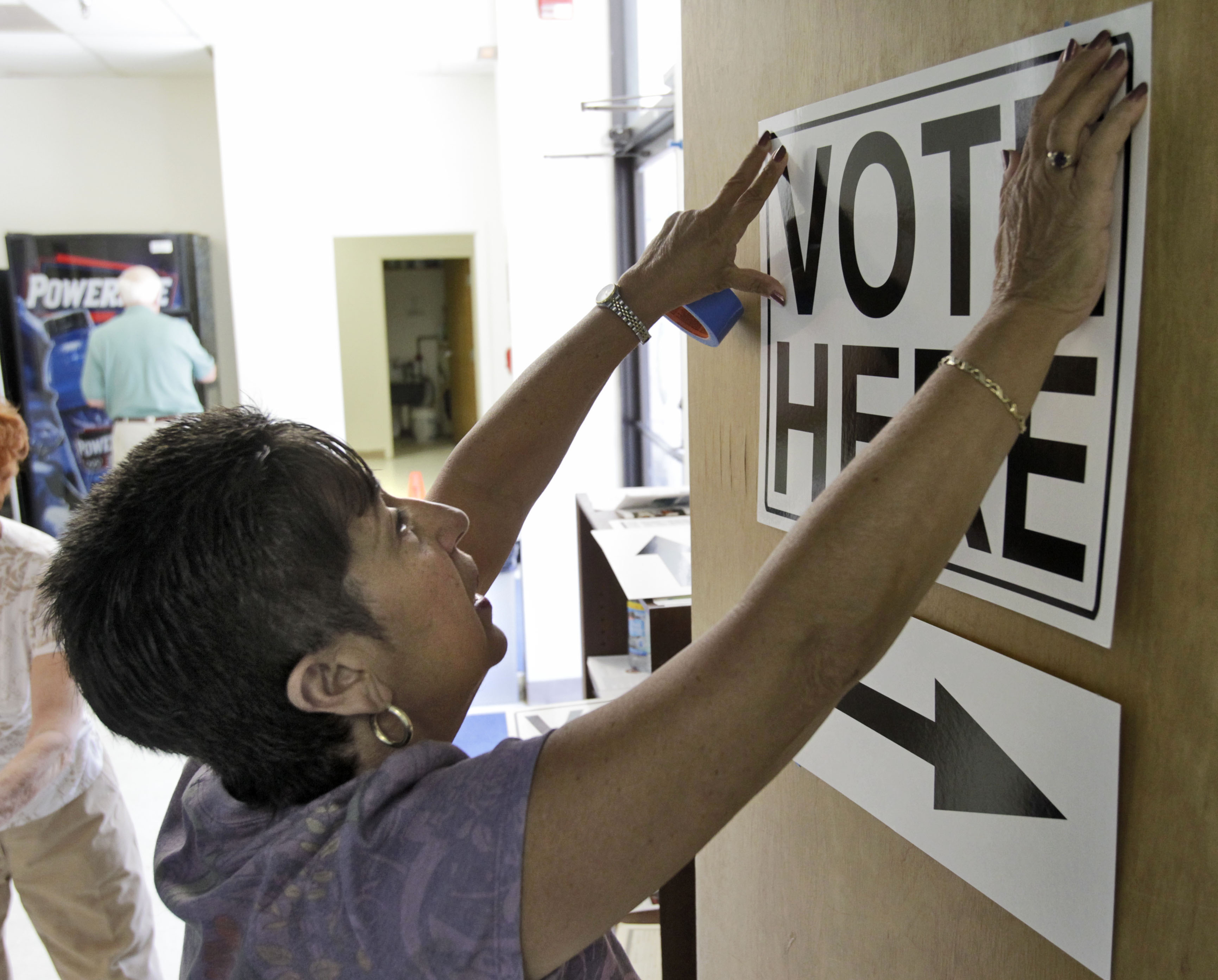 A worker sets up a polling station.
