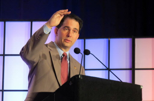 """After months of calling a right to work measure for Wisconsin a """"distraction,"""" Gov. Scott Walker said he would sign a bill being fast-tracked to his desk."""