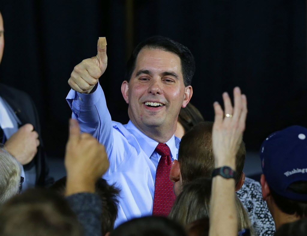 Governor Scott Walker thanks supporters as he wins another term over challenger Mary Burke during his election night rally at the Wisconsin State Fair Park Exposition Center in West Allis, November 4, 2014. Milwaukee Journal Sentinel photo by Rick Wood