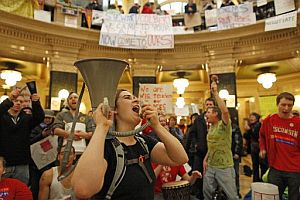 Protestors demonstrating inside Wisconsin's Capitol.