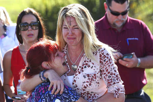 Parents wait for news after a reports of a shooting at Marjory Stoneman Douglas High School in Parkland, Fla., on Wednesday, Feb. 14, 2018. (AP)