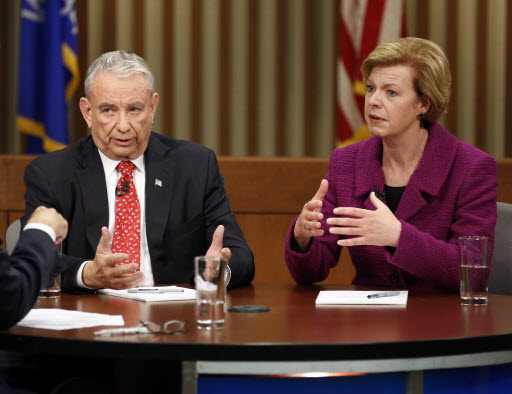 Tommy Thompson and Tammy Baldwin exchanged remarks in the final US Senate debate, on Oct. 26, 2012